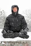man meditating in winter