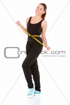 woman with measuring tape around her waist