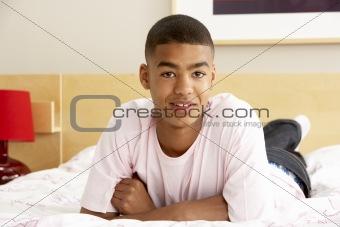 Portrait Of Teenage Boy In Bedroom