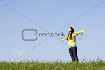 Teenage Girl Standing In Summer Meadow