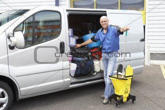 Cleaner standing next to van