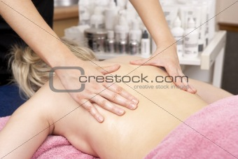 Close Up of female masseuse with client
