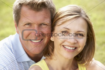 Close up of middle aged couple outdoors