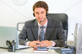 Portrait of smiling modern manager with headset