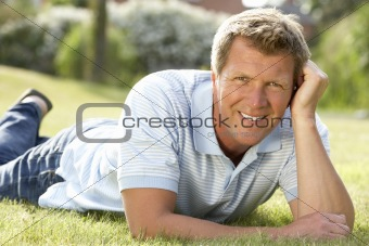 Portrait of young man relaxing in countryside