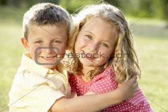 2 Children hugging outdoors