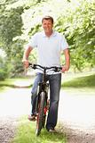 Young man riding bike in countryside