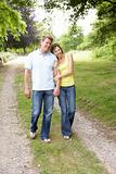 Middle aged couple walking in countryside