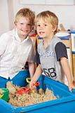 Two Young Boys Playing Together in Sandpit