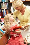 Grandmother and grandaughter in bookshop