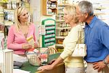 Female sales assistant in health food store