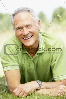 Portrait of mature man relaxing in countryside