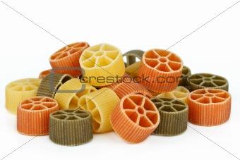 Tricolor pasta on white