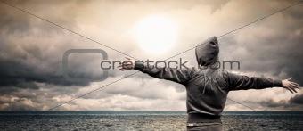 Girl looking at ocean dawn