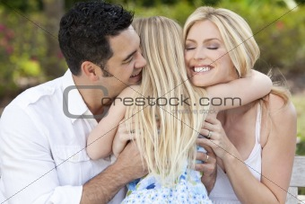 Girl Child Hugging Happy Parents In Park or Garden