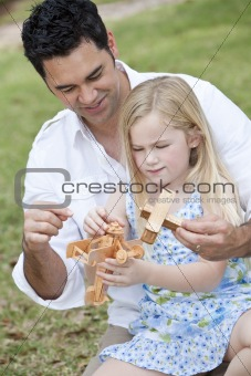 Father and Daughter Playing With Toy Airplanes