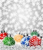 Colorful Snowflake Ornaments on Snow