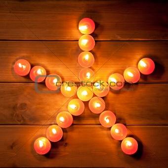 christmas candles pentagram star on wood