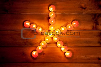 christmas candles pentagram star on wood