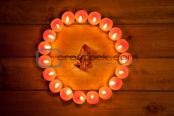 christmas candles circle over wood and symbol