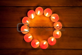 candles cirlce shape on warm golden wood