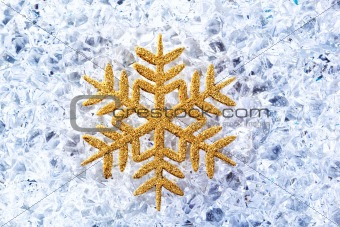 chritmas golden snowflake symbol on ice