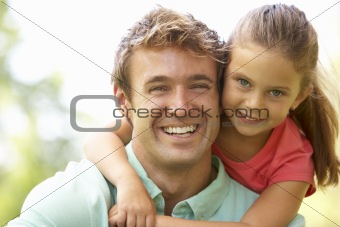 Portrait Of Father And Daughter In Park