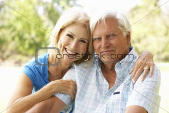 Portrait Of Senior Couple In Park