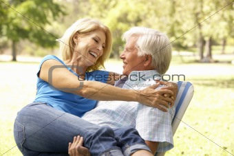 Portrait Of Senior Couple Enjoying Day In Park