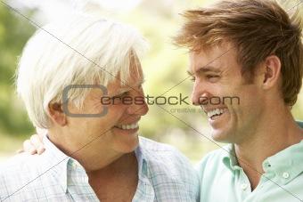 Portrait Of Senior Man Talking To Adult Son