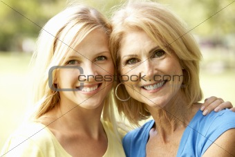 Portrait Of Senior Woman With Adult Daughter
