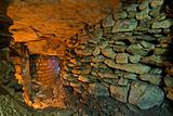 The stone wall in the underground catacombs.