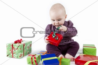 young child unpacking presents