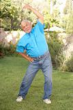 Senior Man Exercising In Garden
