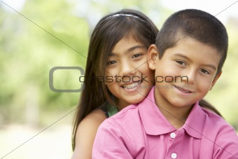 Portrait Of Brother And Sister In Park