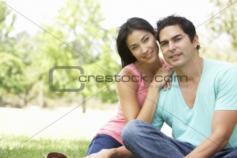 Portrait Of Young Couple In Park