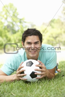 Portrait Of Young Man In Park With Football