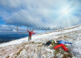 Family on autumn  mountain plateau first winter snow