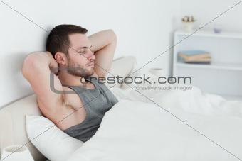 Tired man waking up