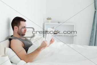 Calm man reading a newspaper