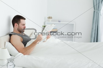 Serene man reading a newspaper