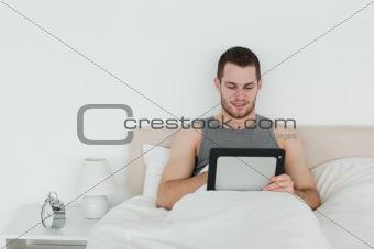 Beautiful man using a tablet computer