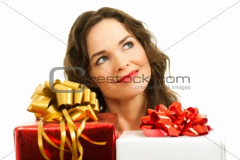 Beautiful young woman choosing christmas presents