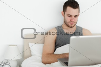 Attractive man using a laptop