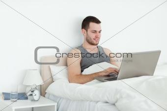 Calm man using a laptop