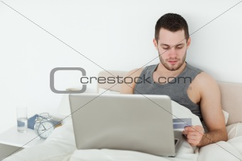 Attractive man shopping online