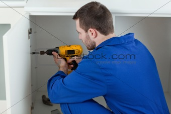 Handyman fixing a door
