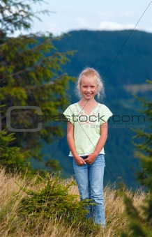 Girl in summer mountain