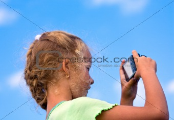Little girl with photo camera