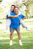 Senior Couple In Sports Clothing Having Fun In Park